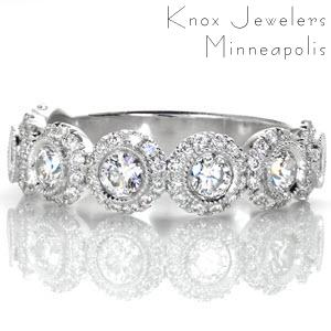 Custom unique wedding rings in Phoenix with bezel set round diamond each surrounded by a diamond halo.