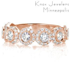 Custom unique rose gold wedding rings in San Diego with bezel set round diamond each surrounded by a diamond halo.