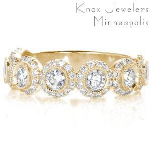 Custom unique wedding rings in Nashville with bezel set round diamond each surrounded by a diamond halo.