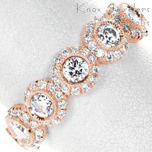 Rose gold wedding band in Anaheim with seven round diamonds surrounded by dazzling halo of smaller diamonds.