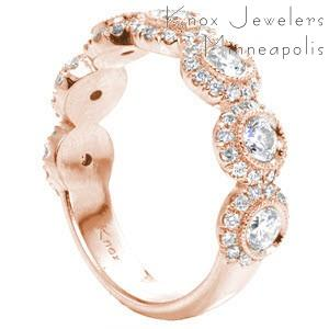Custom unique rose gold wedding rings in Miami with bezel set round diamond each surrounded by a diamond halo.