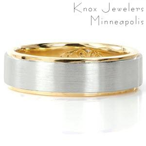 Gent's two-tone band is custom created in 18k yellow gold and platinum. High polish rails outline outer edges of the band in yellow gold. A brushed finish is applied to the platinum center for a unique contrast. The Design also features a personalized insert panel.