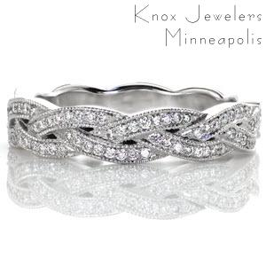 This unique slim woven band is created of seamlessly intertwining elements.  Each segment is elegantly braided with micro pave diamonds and edged with mil-grain texture.  The braided criss-cross design adds dimension to this band. It can be worn as a wedding band or a fashion ring.