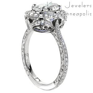 Victoria custom engagement ring with a unique antique inspired basket design topped with a diamond halo and a oval cut center diamond.