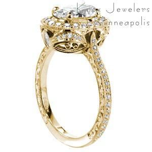 Redwing custom engagement ring with a unique antique inspired basket design topped with a diamond halo and a oval cut center diamond.