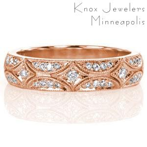 Dazzling rose gold wedding ring in Hartford features a micro pave star burst pattern.