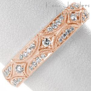 Star burst patterned rose gold wedding band in Seattle, Washington. This micro pave wedding ring is shown in rose gold for a captivating look.