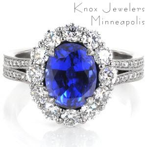 This vintage-inspired design is mesmerizing with a 2.20 carat oval cut blue sapphire surrounded by a dazzling halo. This intricate design is adorned with micro pavé diamonds leading down its split shank. The side profile reveals a beautifully crafted  basket with micro pavé embellishments.