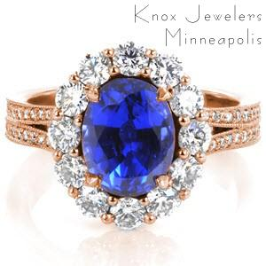 Schenectady custom engagement ring with an oval blue sapphire surrounded by a diamond halo on a split shank band