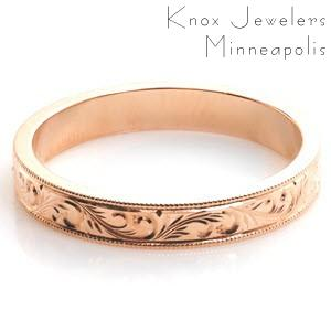 Rose gold wedding ring in Dayton with scroll hand engraving and milgrain border.