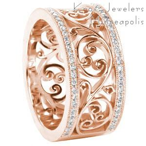 Rose gold wedding ring in Cleveland with diamond bands between a filigree center pattern.