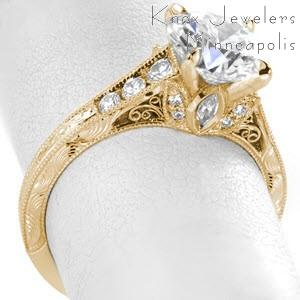 Antique engagement ring in Las Vegas with round brilliant center stone, hand engraving and filigree.