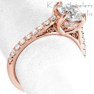 Rose gold engagement ring in Colorado Springs with micro pave diamonds and round brilliant center stone.