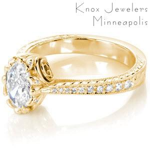 Antique inspired custom engagement ring with an oval cut diamond center with a tapering band featuring bead set diamonds, hand engraving and milgrain edging in Las Vegas.