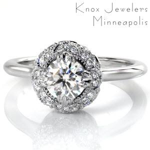 Custom engagement ring in Providence with a unique antique inspired halo surrounding a round diamond center stone.