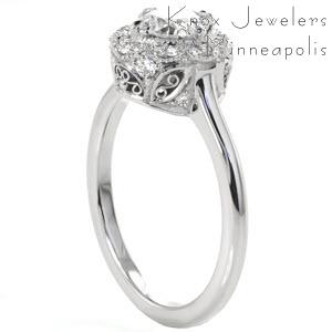 Beautiful antique halo engagement ring in Austin features a detailed basket with hand formed filigree curls.
