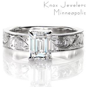 Design 3063 features a regal 1.00 carat emerald-cut central diamond. The long rectangular diamond facets contrast beautifully with its delicately engraved band.   Intricate patterns of hand engraving and textured milgrain edges possess a truly vintage charm. This wide band solitaire is a forever classic.