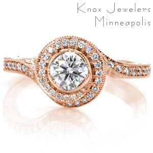 Custom engagement ring with a unique twisting diamond halo surrounding a round brilliant center stone in Ann Arbor.
