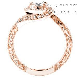 Rose gold halo engagement ring in Orlando is a stunning custom design. This unique rose gold engagement ring features a twisted halo with a micro pave band and relief style engraving.