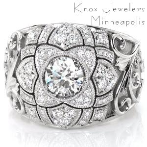 Design 3096 is an intricate tapestry of relief engraving, stippled background and bead-set diamond leaves surrounding a floral-inspired center. This tapered band features a 0.70 carat round brilliant diamond encircled by mil-grain edged micro pavé diamond petal shapes and outlined in scroll hand-engraving.