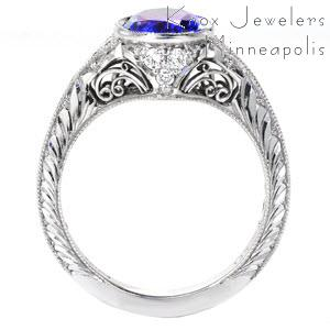 Des Moines unique engagement ring with hand engraving and filigree curls featuring a oval cut blue sapphire.
