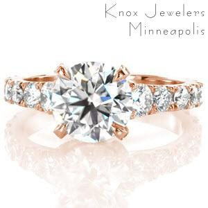 Beautiful rose gold engagement ring in Chicago featuring stunning graduating side diamonds on a flared band.