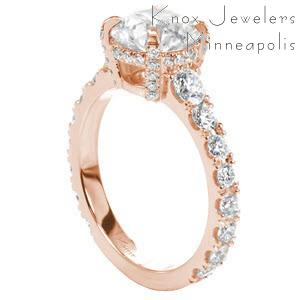 Custom rose gold classic engagement ring with a round center diamond held by four diamond set prongs atop a graduating diamond band in Charleston.