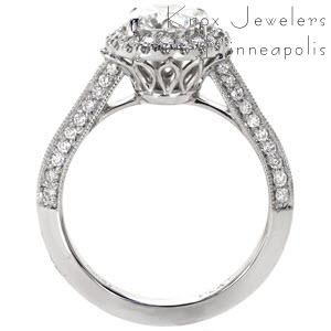 Custom engagement ring in Dayton with a unique pierced undercarriage topped with a halo framed round center diamond.