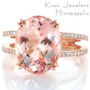 A blushing beauty, this 5.75 carat oval morganite is complimented by the warmth of 14K rose gold. A split shank of glittering prong set micro pavé diamonds draw in focus to the extraordinary center stone. The basket setting and double claw prongs offer both style and security.