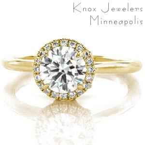 Miami halo engagement ring with round brilliant center stone and yellow gold setting.