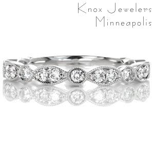 Oklahoma City wedding rings with scallop shapes and round diamonds.