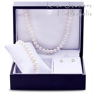 Our classic freshwater pearl set. Includes necklace, bracelet, and a pair of studs. Pearls are near round white freshwater measuring between 6.0-6.5mm. The necklace is 18 inches long, and the bracelet measures 7.5 inches. Nicely finished wooden box is included. Limited Supply.