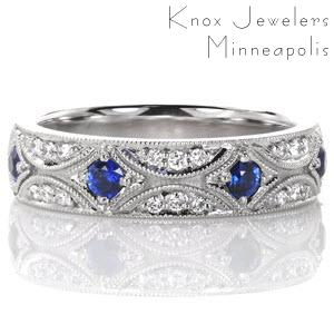 Denver unique wedding bands with hand engraving and micropave diamonds. This vintage style wedding band features a star burst pattern decadently set with diamonds and rich blue sapphires. Milgrain edging really captures the antique feel of the design.