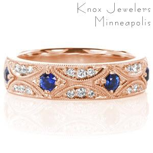 Henderson wedding ring with diamonds and vibrant blue sapphires in rose gold.