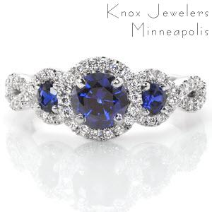 Washington D.C. halo engagement ring with three blue sapphires and woven band.