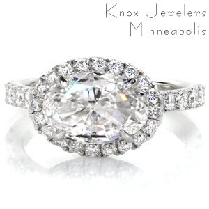 Des Moines custom engagement ring with u-cut micro pave diamonds surrounding a horizontal set oval center.