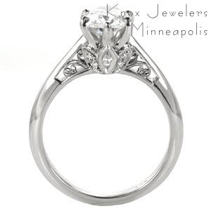 Unique solitaire engagement ring custom created around an oval diamond center held by six prongs with a floral and filigree design profile in Columbia.