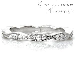 Design 3231 is an elegant scalloped piece that works great as a fun ring, part of a stacker set, or as a wedding band. The beaded milgrain texture along the edges of the band creates a cohesive whole with the beadset round diamonds. High polished sides show off the beautiful luster of the metal.