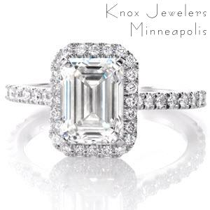 Halo engagement ring in Fargo with emerald cut center stone and white gold setting.