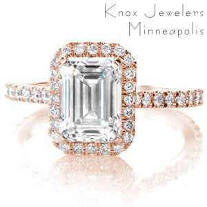 Rose gold halo engagement ring in Cedar Rapids, Iowa. The emerald cut center stone is surrounded by a brilliant micro pave halo with a micro pave rose gold band.