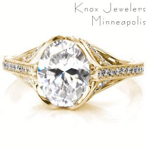Montreal engagement ring with oval center stone and yellow gold diamond setting.