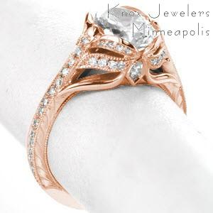 Fargo antique engagement ring with hand engraving in a rose gold setting.