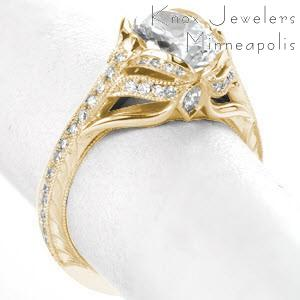 Memphis antique engagement ring with oval center stone, hand engraving and diamonds.