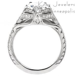 St Louis custom created engagement ring with antique inspired details including center petal prongs holding an oval center and arching bead set diamonds.