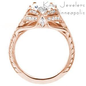 Green Bay custom created rose gold engagement ring with antique inspired details including center petal prongs holding an oval center and arching bead set diamonds.