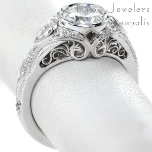 Antique engagement ring in Raleigh with filigree, milgrain and bezel set round center.