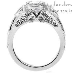 Schenectady custom engagement ring with a unique side profile featuring bead set diamonds and filigree curls.