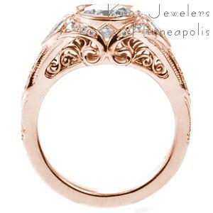 Fargo custom engagement with a round diamond center stone and antique details including profile filigree curls.