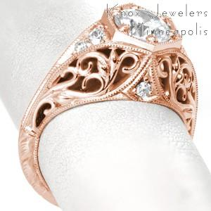 Rose gold engagement ring in Nashville with filigree,  round center stone and octagonal size prong mounting.