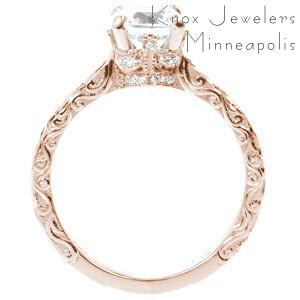 Rose gold engagement ring in Ottawa with relief engraved band, micro pave diamonds and round center stone.